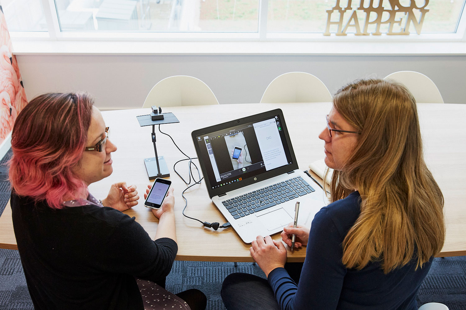 Two women discuss issues during snapshot user testing