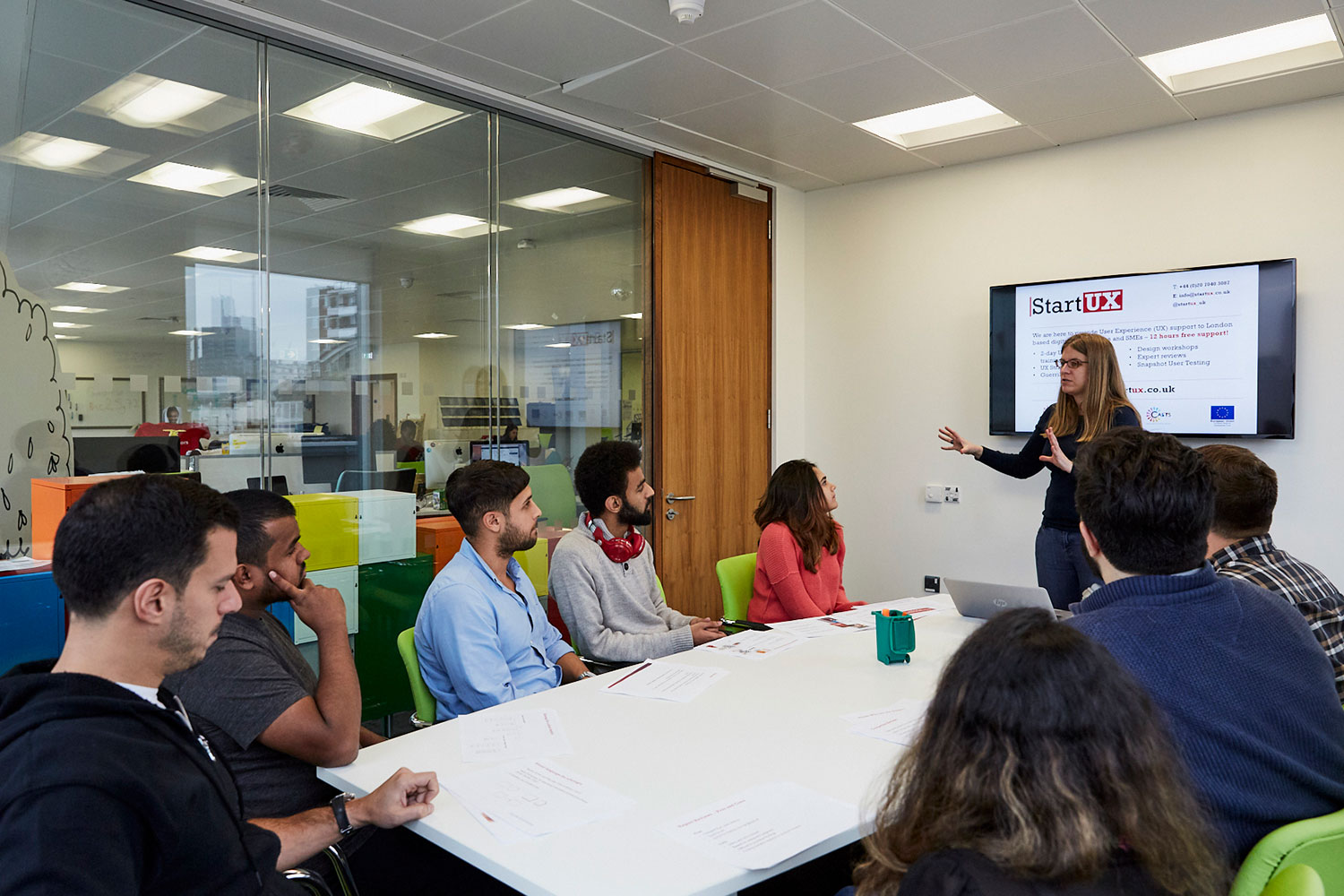 Woman addresses trainees in meeting room